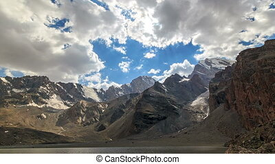 Rays of sun in the mountains. Panorama. TimeLapse. Pamir,...