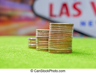 Stack of US. dallor coins with Las vegas sign background