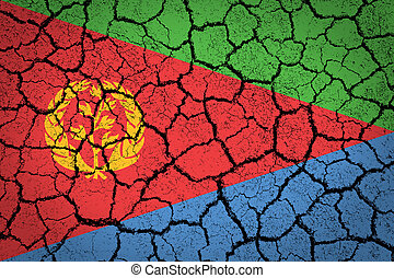 Eritrea flag painted on a cracked ground