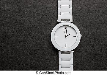 Beautiful, white watch with a diamond.