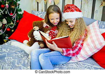 little girls read book, Christmas time
