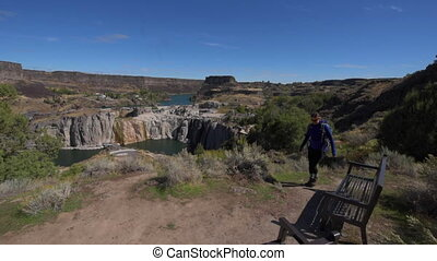 Shoshone Falls Girl taking pictures with her smartphone -...