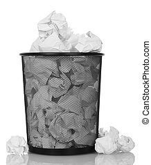 Metal basket overflowing with crumpled paper isolated on...