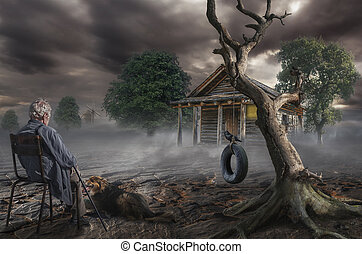 memory - an elderly gray-haired man sits near a dry tree on...