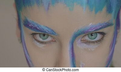 Glamour girl with art makeup of the snow queen looking to...
