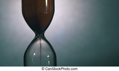 Hourglass on a White Background, the sand Falls Inside -...