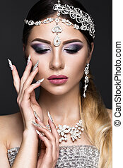 Beautiful girl in image of Arab bride with expensive jewelry, oriental make-up and bridal manicure. beauty face.
