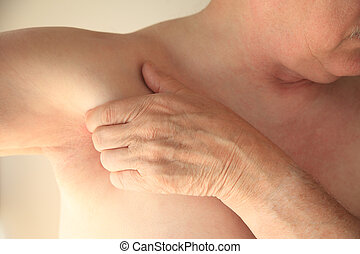 Man with hand near armpit - Older man has a hand next to his...