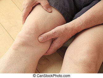 Man with pain in his upper leg