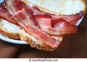 Making a bacon butty - Using thick-sliced bacon to make a...