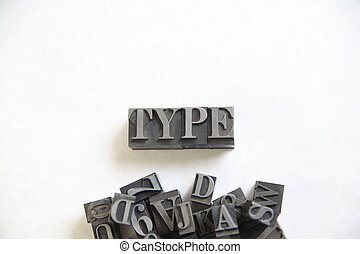 Type word with copy space - The word type in metal letters...