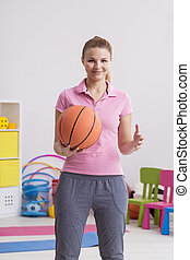 Physiotherapist with basketball
