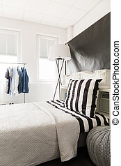 Cozy bed for a man - View of the bed with bright bedding and...