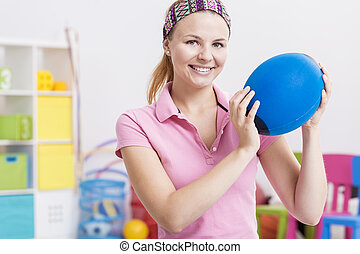 Physiotherapist holding ball