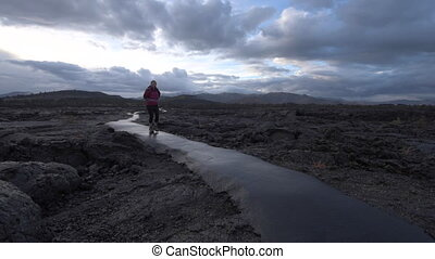 Hiker in Crater of the Moon National Monument - Hiker...