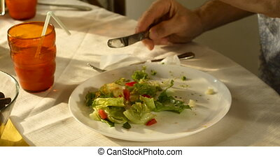 Someone eating healthy food, salad with fresh vegetables, close up