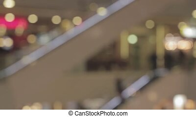 Crowded people on escalator in a shopping mall Hyperlapse blurred video