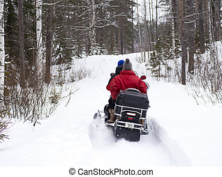 Snowmobile is accelerating in the forest - Sweden lapland in...