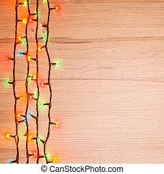 Christmas lights on wood - Christmas lights of different...
