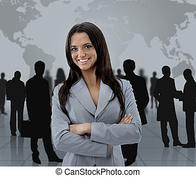 Happy young business woman standing in front of her team