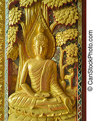 Golden Sculpture High-relief buddha on gate to sanctuary in...