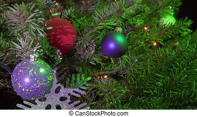 Christmas fir-tree decorated with New Year's ball.