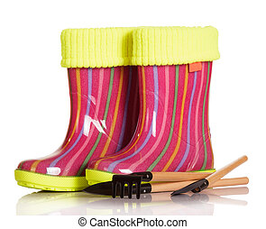 Children rubber boots with fabric inset, shovel and rake...
