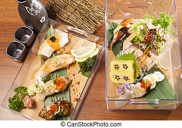 Many Sushi with various type topping in platic box - Many...