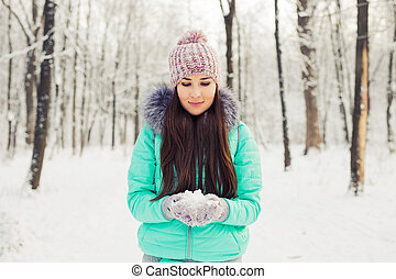 Young woman with snow