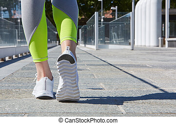 Woman ready to run outdoor in the city, sunny day - Woman...