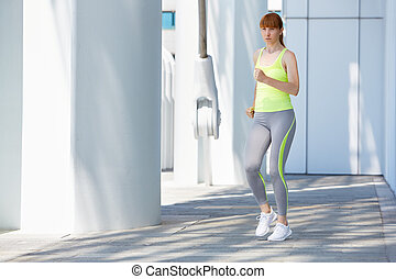 Woman running outdoor in the city, sunny day - Woman running...