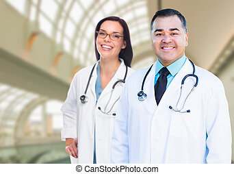 Two Doctors or Nurses Inside Hospital Building - Two Male...