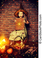 miracles happen - Cute little girl in witch costume with...