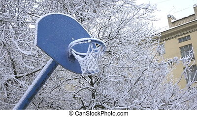 Snow covered basketball playground. Snow covered basketball...