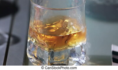 Glass of Whiskey Close Up - Glass of Whiskey With Ice On...