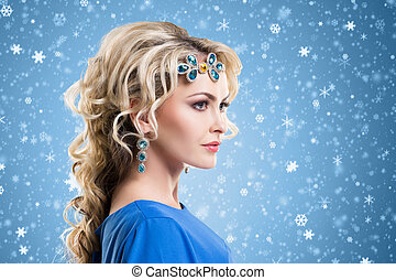 Beauty portrait of a blond girl with jewelry on her hair -...