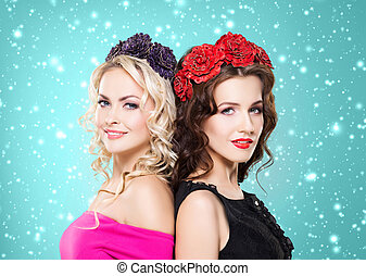 Portrait of two young women with flower hairbands - Beauty...
