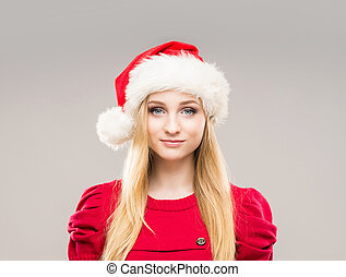 Portrait of a happy teenage girl in a Christmas hat -...