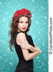 Beautiful brunette with a bright red flower headband -...