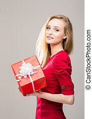 Portrait of a young girl with a Christmas gift box -...