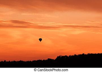 Hot air balloon flying at sunset sky - Hot air balloon...