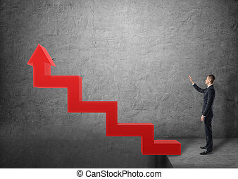 Businessman standing near stairs in the form of red arrow...