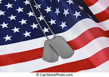 military dog tags on flag - close up of military dog tags on...