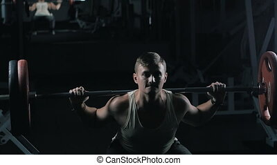 Man doing barbell workout routine in gym, healthy lifestyle