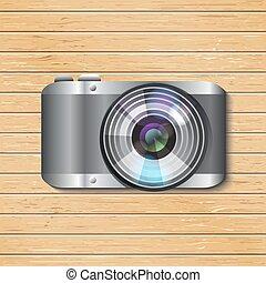 Vector digital camera. Gray metal shining case. Big blicking...