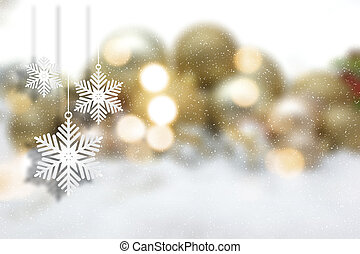 Hanging Christmas snowflakes on a defocussed background -...