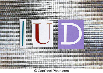IUD concept - IUD (Intra Uterine Device) acronym on grey...