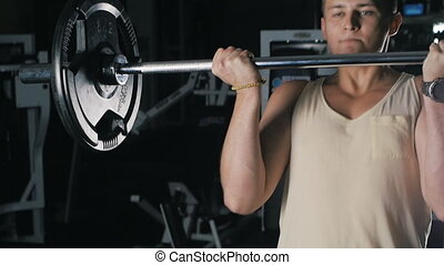 Side view of athlete doing Barbell Curl