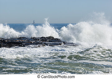 Asbury Park Beach - Waves crash over the jetty in Asbury...