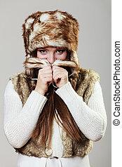 Attractive woman in fur cap - Winter female fashion....